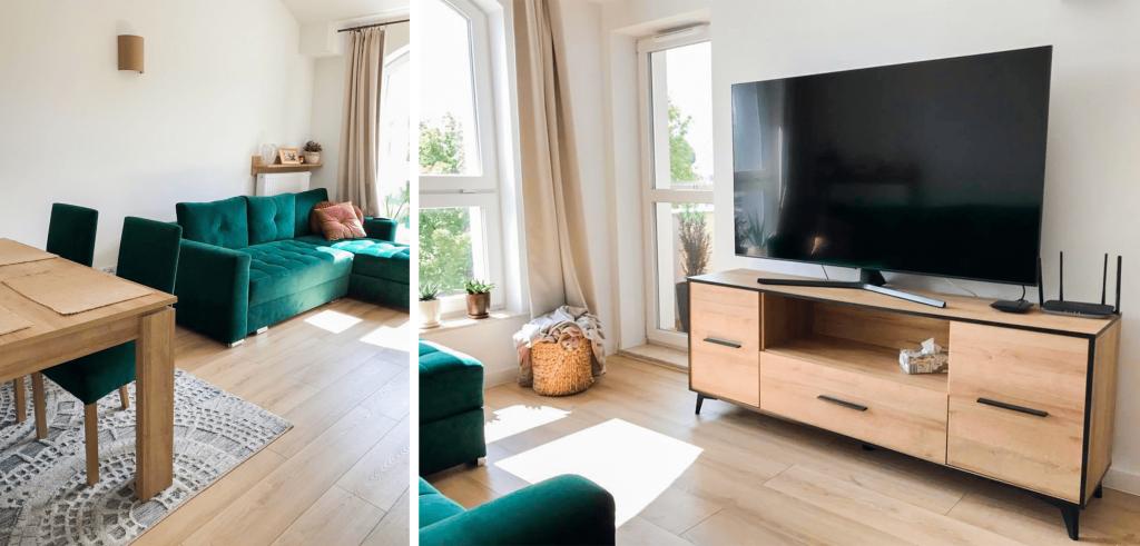 Salon z butelkowy zielonymi dodatkami i szafka pod telewizor z czarnymi akcentami